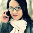 Young woman using mobile phone outdoors — Stock Photo #17149525