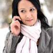 Young woman using mobile phone outdoors — Stock Photo #17149901