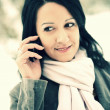 Young woman using mobile phone outdoors — Stock Photo #17150019