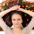 Lovely woman with christmas balls — Stock Photo