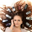 Portrait of happy woman with mobile phones - Stockfoto