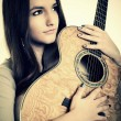 Beautiful Girl playing guitar — Stock Photo