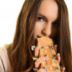 Beautiful Girl playing guitar — Stock Photo