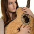 Beautiful Girl playing guitar - ストック写真