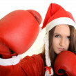 Christmas woman hitting wearing boxing gloves and red santa hat - Lizenzfreies Foto