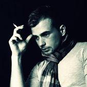 Young man smoking a cigarette — Stock Photo