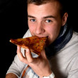 Young Man Eating Pizza — Stock Photo #20070921