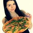 Girl eating a delicious pizza — Stock Photo