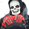 Grim reaper with snowboarder — Stock Photo