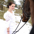 Portrait of a beautiful bride and horse — Stock Photo