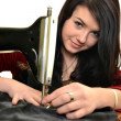 Young caucasian woman using a sewing-machine. — Stock Photo #22084143