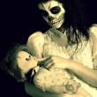 Girl with painting dead mask skull with doll — Stock Photo
