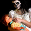 Royalty-Free Stock Photo: Girl  with painting dead mask skull with doll