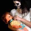 Girl  with painting dead mask skull with doll — Stock fotografie