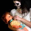 Girl  with painting dead mask skull with doll — 图库照片
