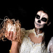 Young woman in day of the dead mask skull face art — Stock Photo
