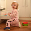 Little girl in kitchen — Stock Photo #23126190