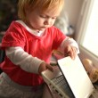 Cute child using laptop — Stockfoto