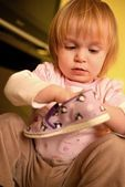 Little girl with sneaker — Stock Photo