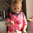 Little girl in kitchen — Stock Photo