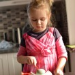 Little girl in kitchen — Stock Photo #23306696