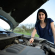 Beautiful woman sad with broken car - Photo