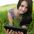 Beautiful young woman in the field - Stock Photo