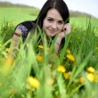 Beautiful young woman in the field — Stock Photo