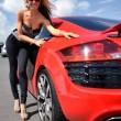 Stock Photo: Beautiful woman near sport car