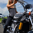 Stock Photo: Girl on a motorcycle