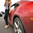 Beautiful woman near sport car — Stock Photo