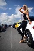 Beautiful woman near sport car — Stock Photo