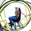 Woman on extreme chair - Stock Photo