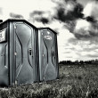 Two portable bathrooms on a cloudy overcast day — Stock Photo