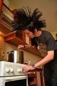 Young punk cooking — Stock Photo
