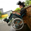 Punk boy in a wheelchair — Photo