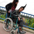 Punk boy in a wheelchair — Stockfoto