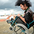 Punk boy in a wheelchair — Stock Photo