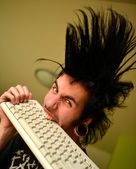 Punk boy with keyboard — Stock Photo
