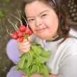 Dawn syndrome woman with radish — Stock Photo