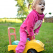 Stock Photo: Cute girl in a little car
