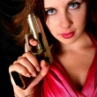 Sexy woman holding gun — Stock Photo #27188875