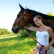 Beautiful woman and horse — Stock Photo #27386639