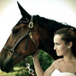 Beautiful woman and horse — Stock Photo #27389143