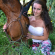 Beautiful woman and horse — Stock Photo #27391733