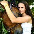 Beautiful woman and horse — Stock Photo #27401233