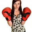 Young woman with boxing glove — Stock Photo
