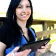 Young woman with digital tablet — Stock Photo