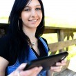 Stock Photo: Young woman with digital tablet