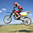 Motocross rider on a practice field — Stockfoto